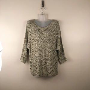 Open knit sweater over sized scoop tribal jeans